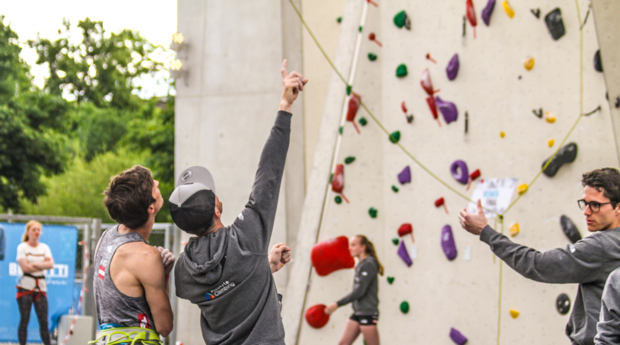 Image Description: Teenagers engaged in a rock climbing wall activity
